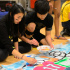 "Sophomores Patty Vitsupakorn and Tim Cho work on the Class of 2017's ""Back in the Day"" banner."