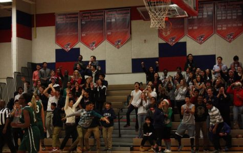 Monticello Maniacs sing holiday tunes during Men's Varsity Basketball Game