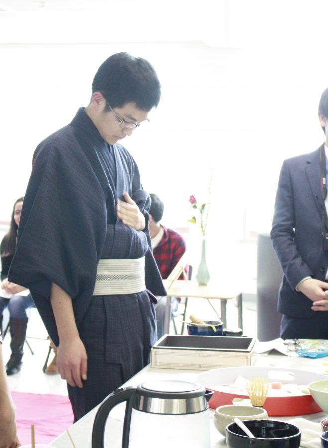 Japanese+exchange+student+Hodaka+Ishibashi+adjusts+his+clothing+before+performing+a+tea+ceremony.