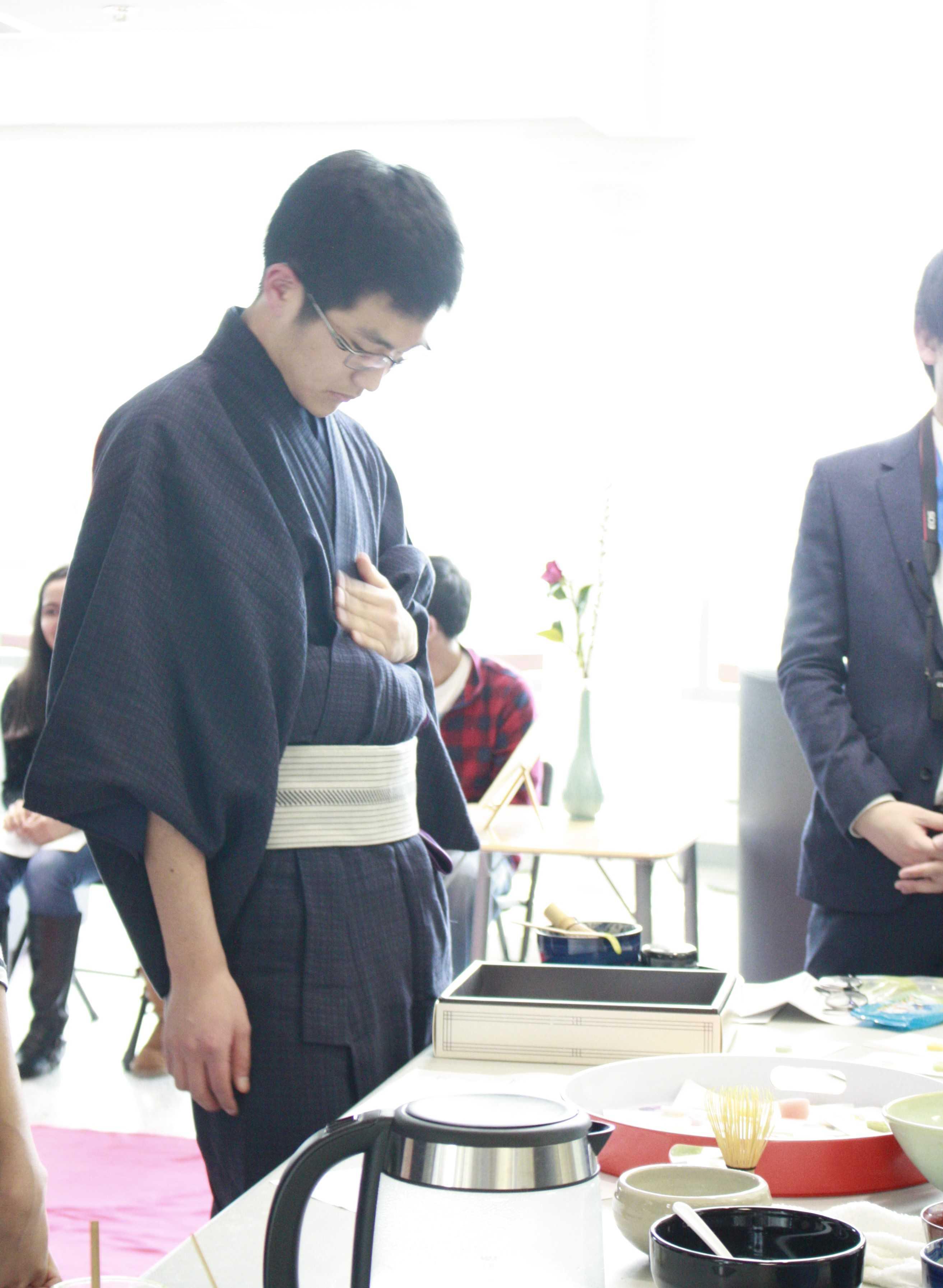 Japanese exchange student Hodaka Ishibashi adjusts his clothing before performing a tea ceremony.