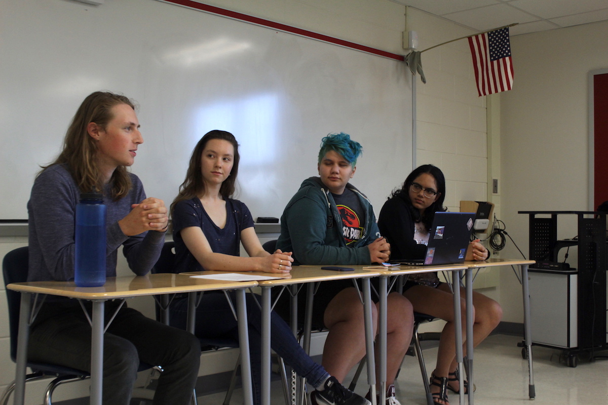 From left to right, senior Sam Libberton, senior Sofiya, junior Ash Rozzi and senior Shraddha Pradeep hold the panel during A-block.