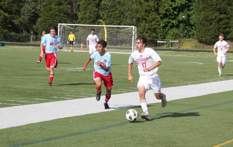 Boys' soccer wins first district tournament game