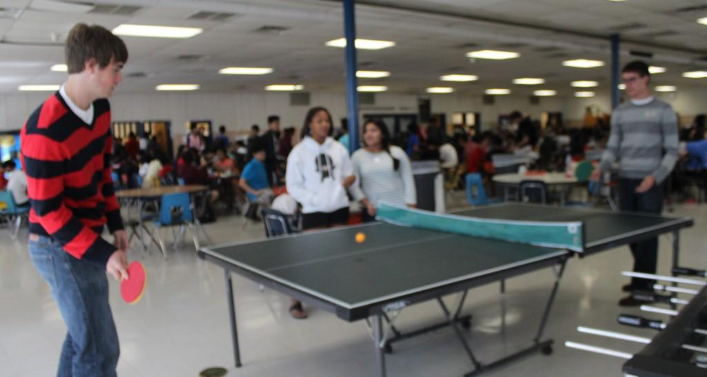 Seniors Joe Nissen and Nate McLean play ping-pong in slounge
