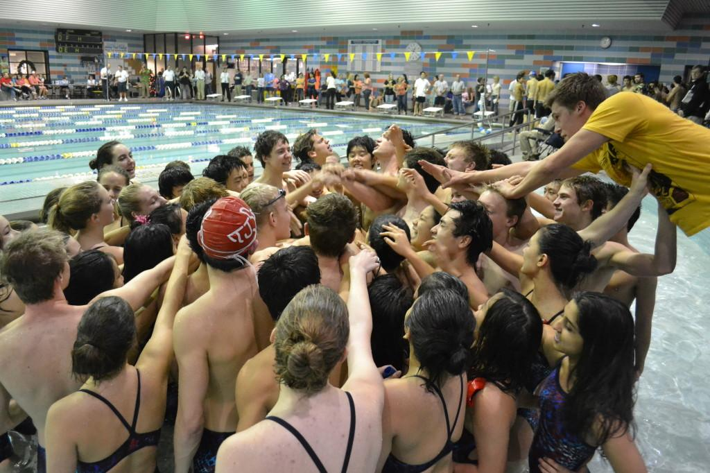 The Thomas Jefferson Swim and Dive Team (TJSD) cheers their way to victory on Friday at the Herndon Community Center.
