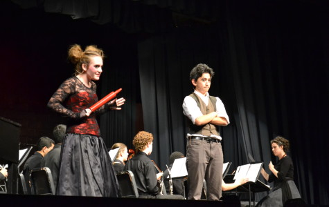 Mrs. Lovett (Senior Julia Ruth) and Sweeney Todd (Sophomore Adam Goldstein) make the decision to cook Todd's victims into meat pies in