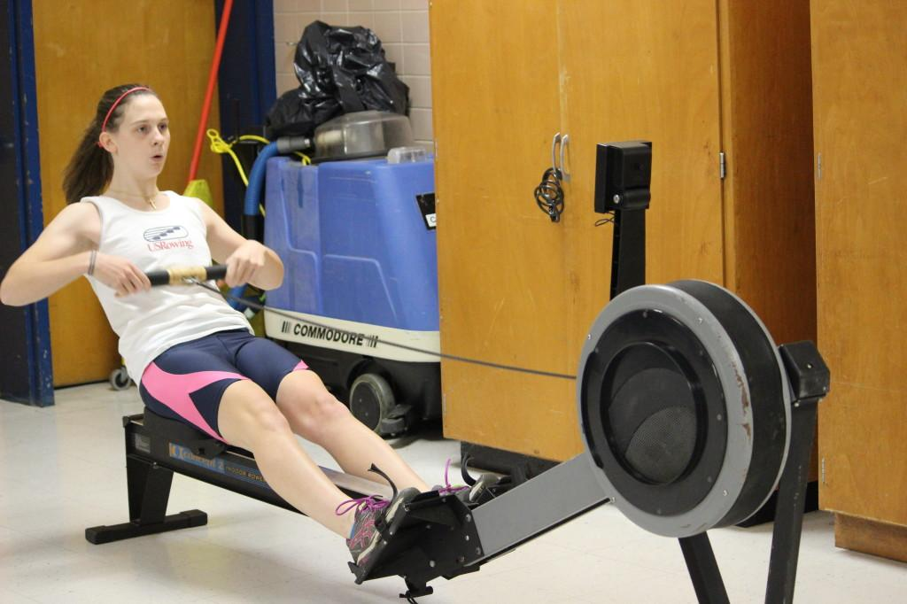 Senior Julia Arthur trains on an erg machine during winter training.