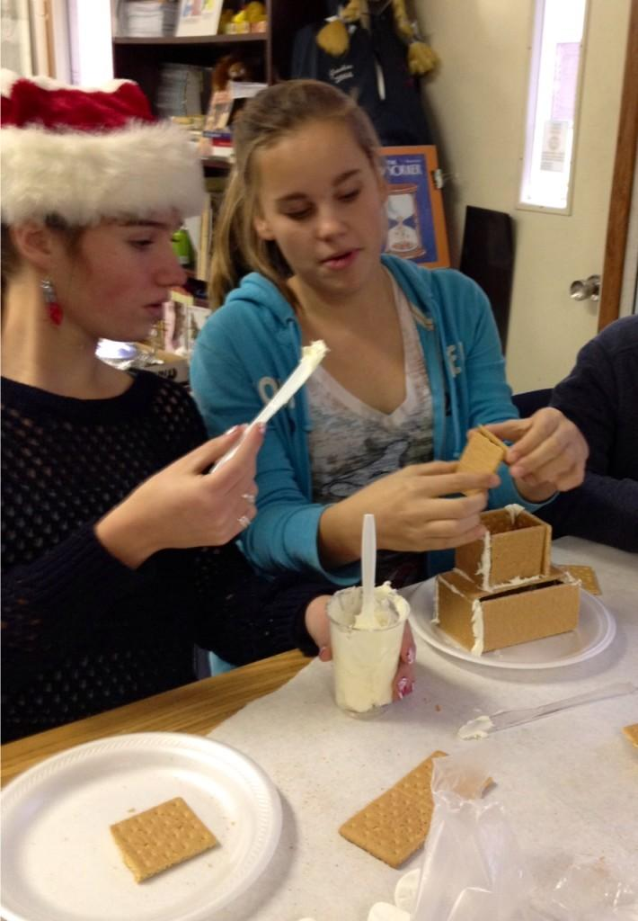 Students+build+and+decorate+festive+gingerbread+houses