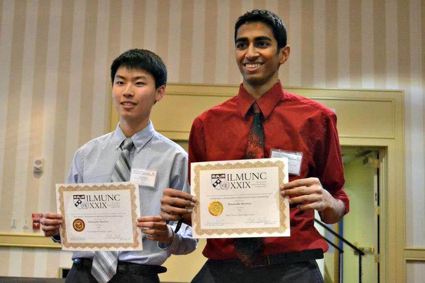Seniors Keven Zhang and Sarthak Sahu display their awards at ILMUNC.