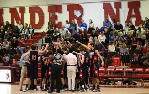 Boys' varsity basketball wins against McLean in a close game