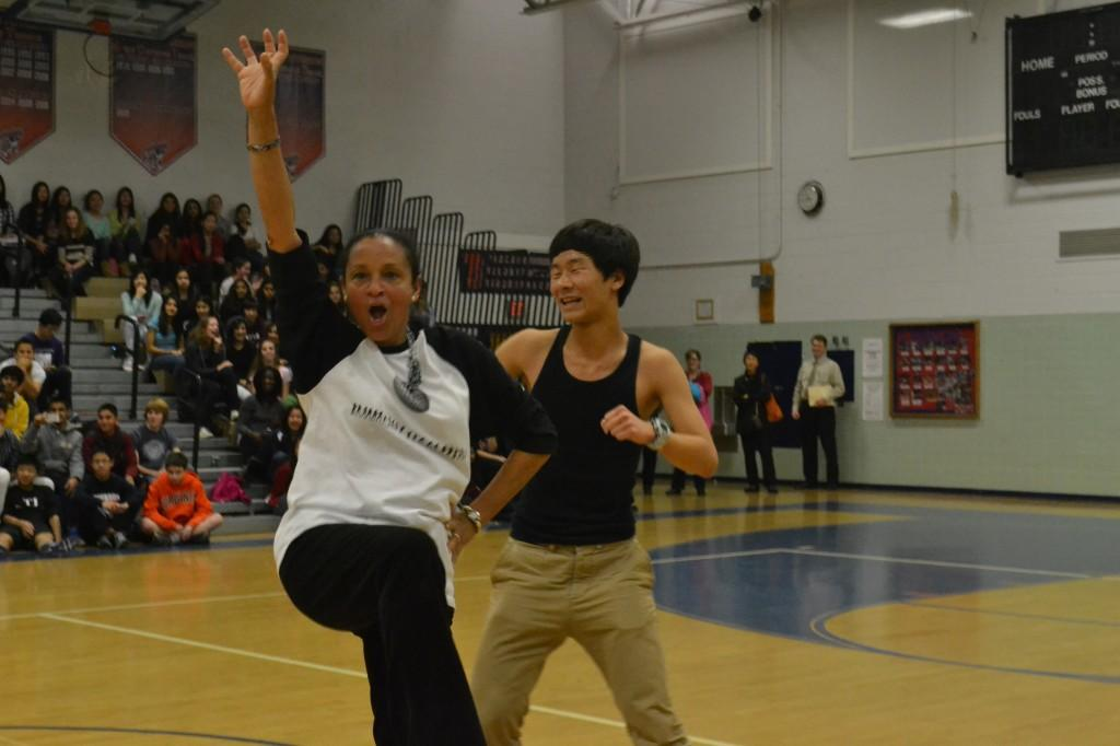 'Dancing with the Faculty' champions, Spanish teacher Alexandra Pou and junior Eric Xie, show off their dance moves at the Winter Sports Pep Rally.