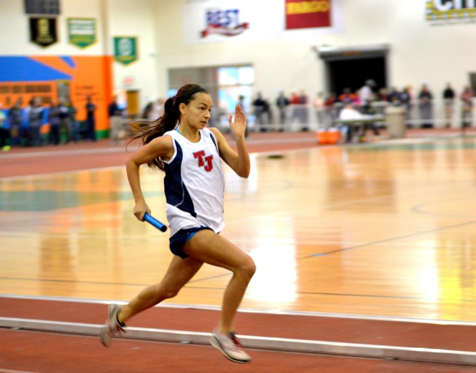 Senior Lizzy Miranda runs at the Suffolk Invitational on Jan. 11