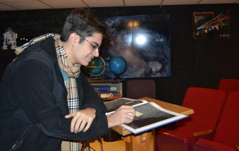 Senior Paul Naanou is studying the fault lines of Mercury.