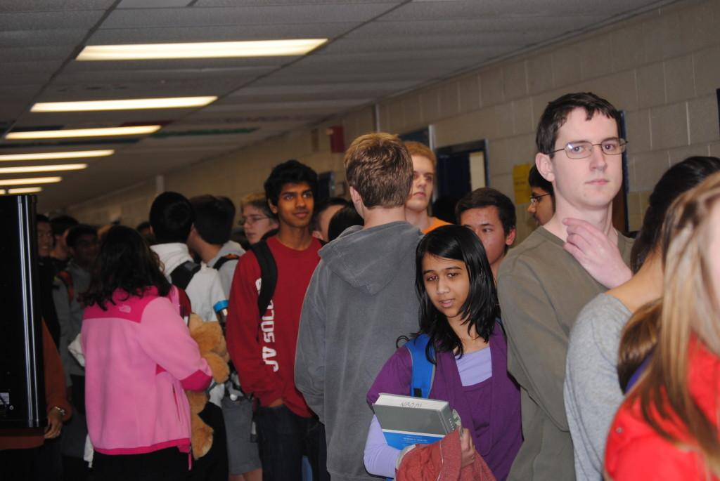 Students fill the hallways outside of the library in an effort to purchase a ticket before they are sold out.
