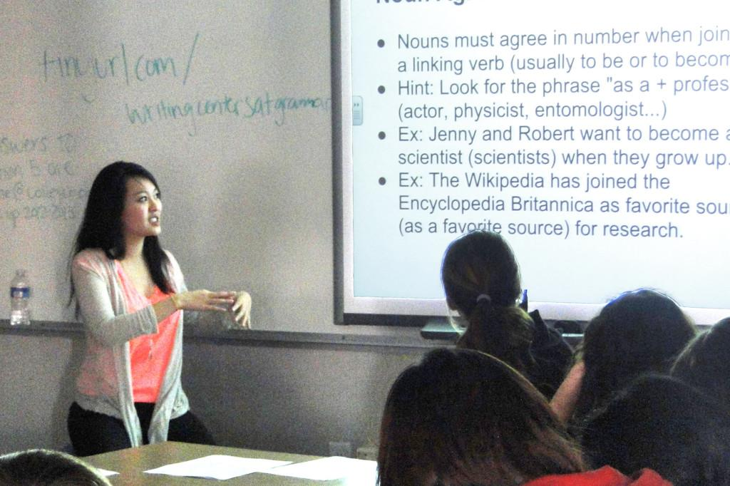 Senior Michelle Wang explains noun agreement concepts to underclassmen preparing for the SAT.