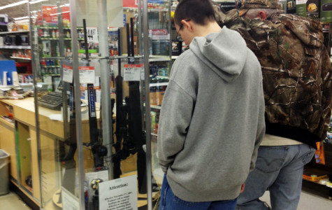 A father and son look at the rifle case at a Wal-Mart in Warrenton.
