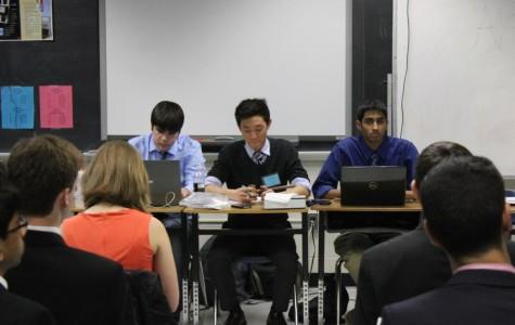 Seniors Zach Moser, Andy Kim and Sarthak Sahu chair the Arab League committee at TechMUN.