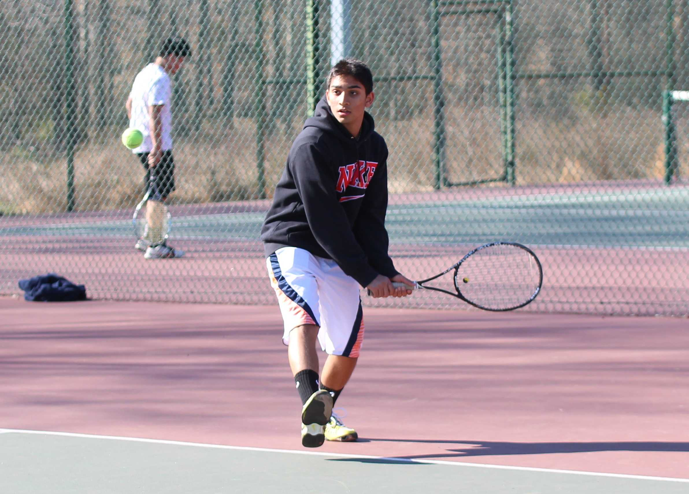 Freshman Abishek Bhargava prepares for a backhand during a practice match on April 2 at Wakefield Park.