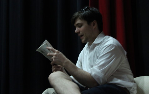 Guest director Zach Roberts reads from the script during a rehearsal.