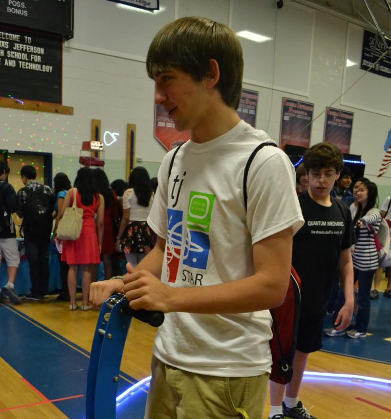 Junior Adam Reiss tries out an ElektorWheelie, a Segway-like self-balancing vehicle.