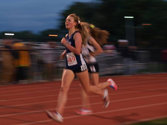Junior Grace Zeng runs the 3200 meter run at Regionals. Photo courtesy of Jane Burhoe Anderson.