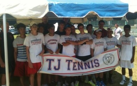 The boys' tennis team smile for the camera after defeating Langley High School at the Virginia AAA state championship.