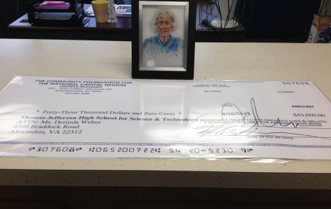 Principal receives check to extend scholarships of Sarah Lahr