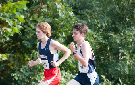 At the PR Kickoff Invitational, sophomores Nate Foss and Eli Lifland pace each other during the sophomore boys race.