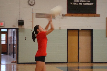 During a scrimmage, sophomore Valerie Chen serves the ball.