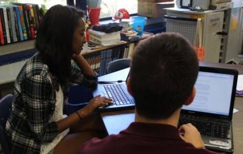 Seniors Sib Shewit (left) and Ricardo Tucker (right) get to work during their first day of broadcast journalism.