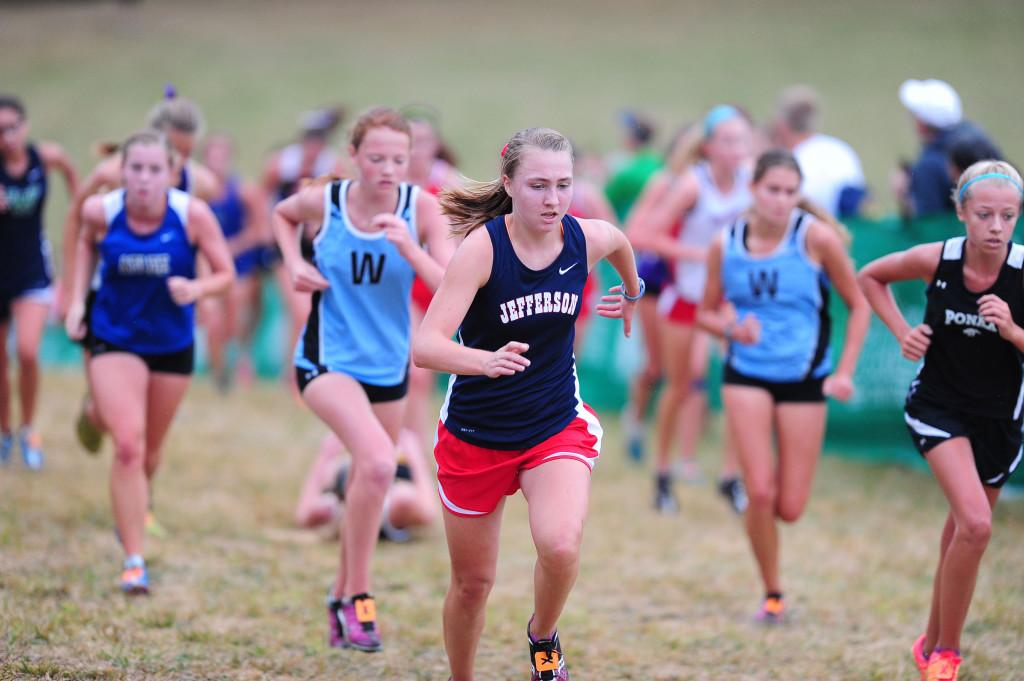 Junior+Haley+Stumvoll+fights+her+way+up+the+infamous+%22Wall%22+in+the+Varsity+A+girls+race.