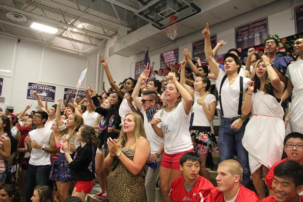 The class of 2014 cheers during their last Friday pep rally.