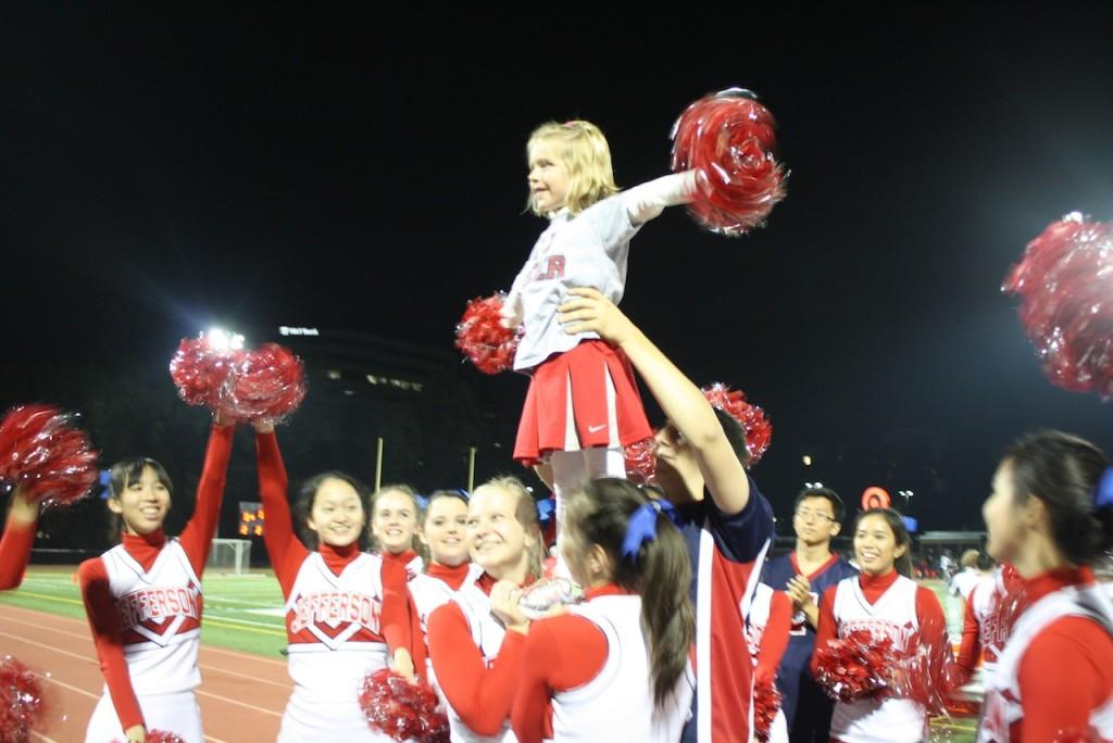 Stunting+with+Jefferson+cheerleaders+at+the+TJ+vs.+Marshall+football+game