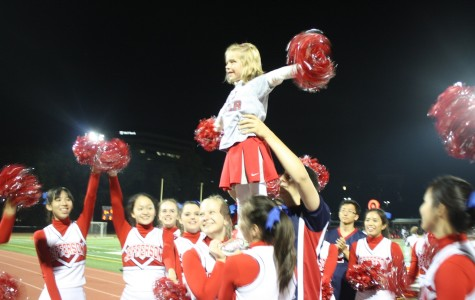 Stunting with Jefferson cheerleaders at the TJ vs. Marshall football game