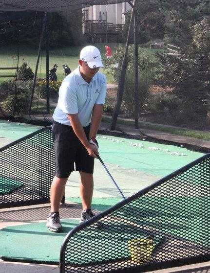 Senior co-captain Chris Prak practices his swing at Pinecrest Golf Course on Sept. 3.