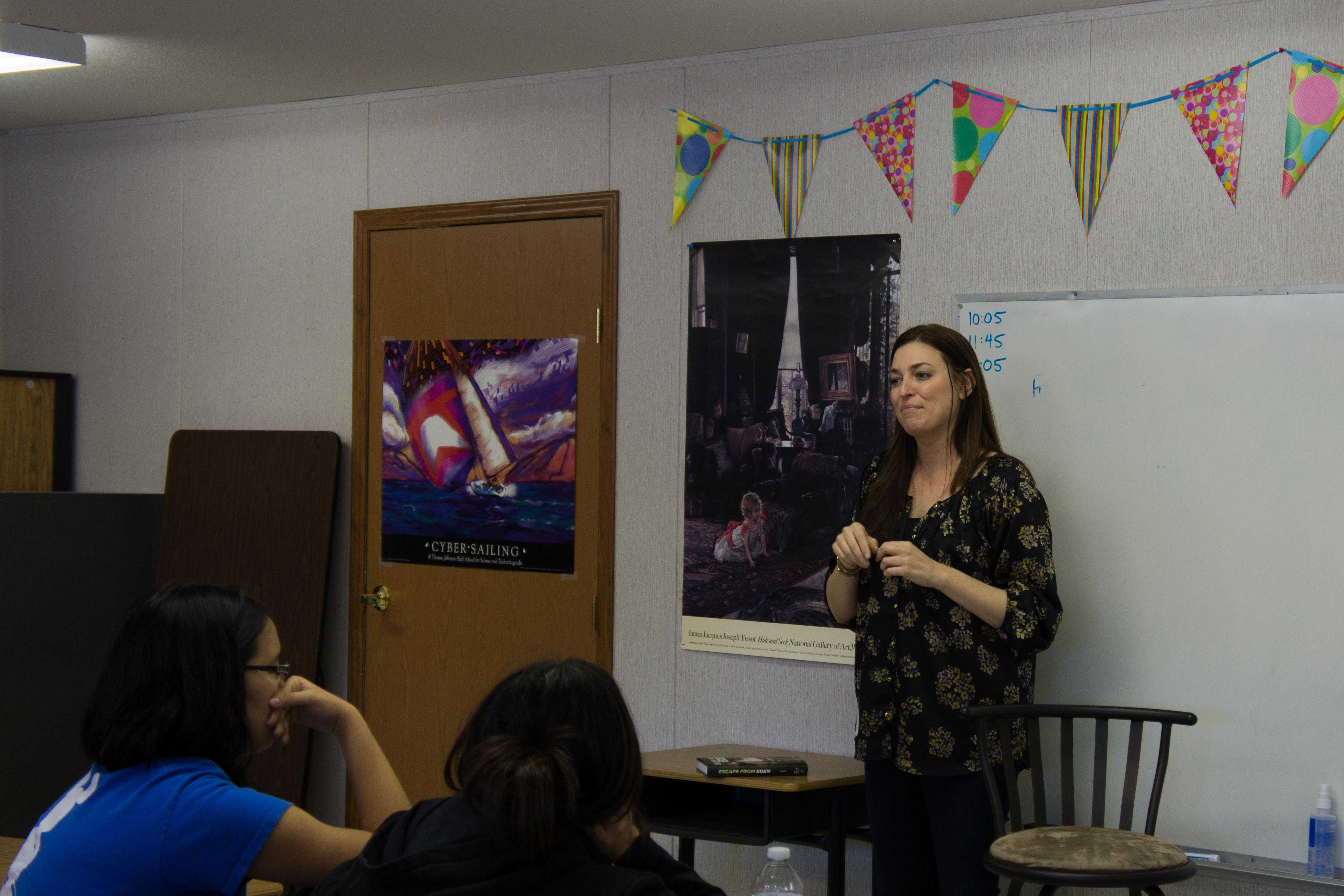 Students listen as debut author Elisa Nader talks about her writing experience.
