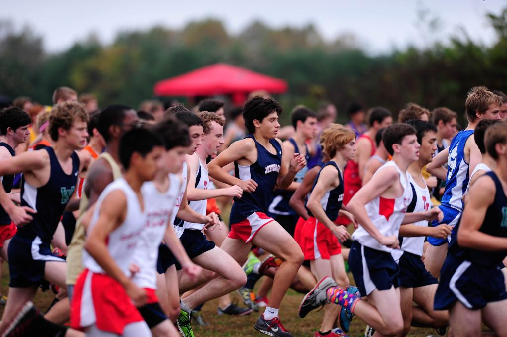 Photo courtesy of Steve Kan. Junior Connor Simpson, freshman Giancarlo Valdetaro and sophomore Nate Foss get off to a strong start at the beginning of the JV Boys race.