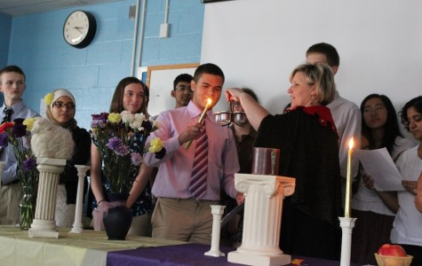Pro-Consul Anthony Carrington lights the candles for the LHS Induction Ceremony.