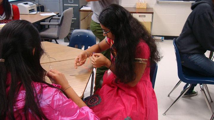 Sophomore Abha Agrawal creates a craft for the Little Sunshine Project.
