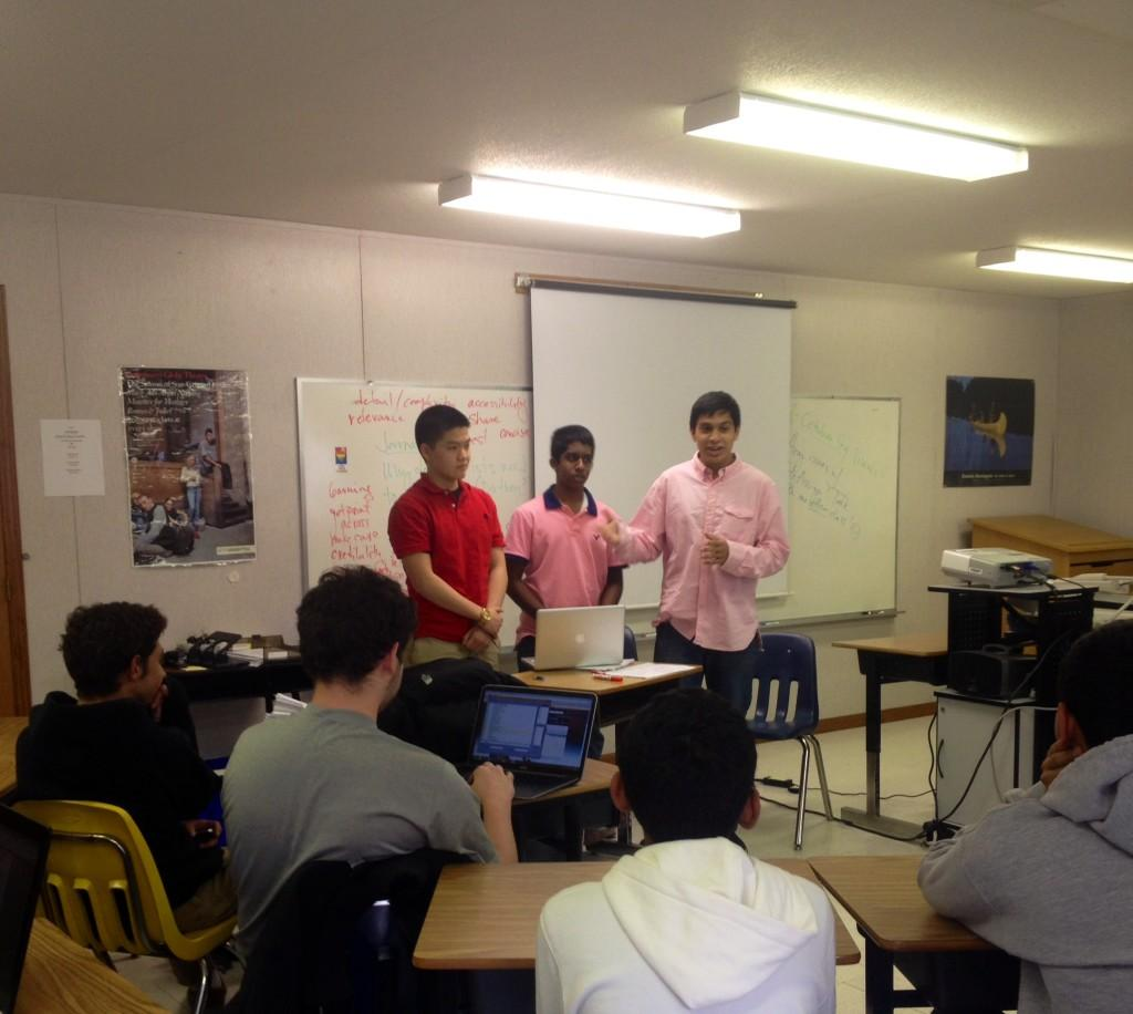 Officers at SciTalk encourage students to participate in a debate on pressing science-related issues.