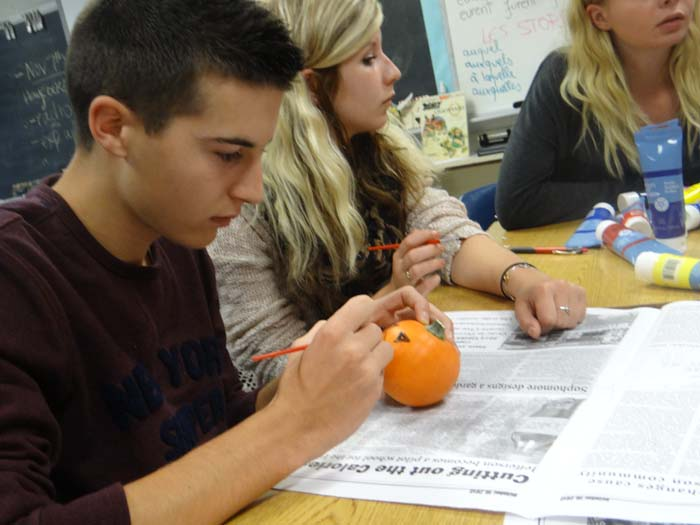 French student Nathan Cocquelet paints a pumpkin at the FHS meeting.