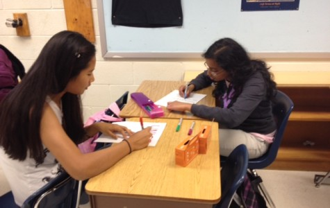 Students create fliers to promote UNICEF's Hunger Banquet, an event that will be held on Nov. 1.