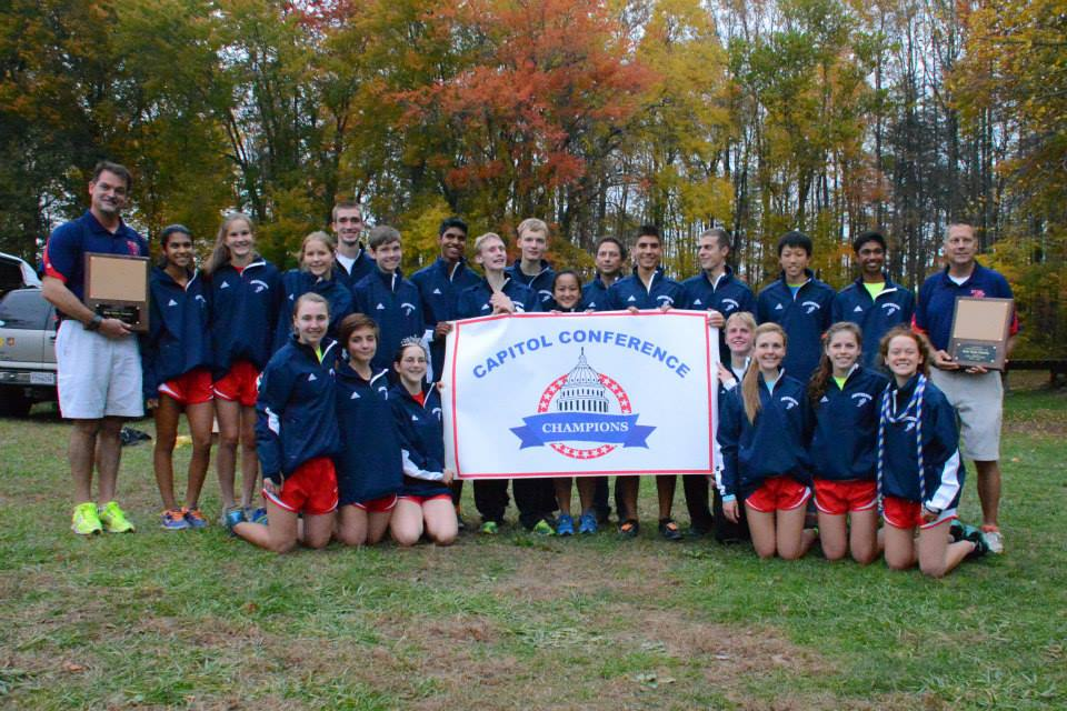 At the Conference 13 district meet, the cross country team took home a double win. Photo courtesy of Sally Stumvoll.