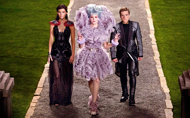 Effie+Trinket+%28Elizabeth+Banks%29+leads+the+way+for+Katniss+Everdeen+%28Jennifer+Lawrence%29+and+Peeta+Mellark+%28Josh+Hutcherson%29+in+%22Catching+Fire.%22+%28Photo+courtesy+of+thehungergamesexplorer.com.%29
