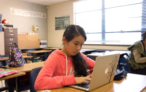 Freshman Emma Zhang works intently on her novel at NaNoWriMo Club.