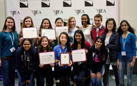 The staff of tjTODAY and Technique stand with the awards received at the Journalism Education Association (JEA)/National Student Press Association (NSPA) Fall National High School Journalism Convention from Nov. 14 to 17. Photo by Ellen Kan.