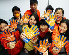 People around the world spread awareness by wearing orange. Photo courtesy of www.un.org.