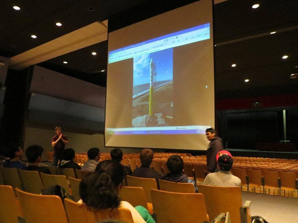 On Nov. 8, Energy Systems Lab Director Adam Kemp and senior Rohan Punnoose give a presentation about the satellite in the auditorium on Nov. 8.