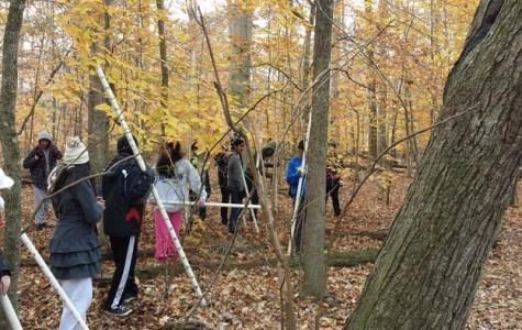 IBET students work on surveying Elizabeth Hartwell Mason Neck National Wildlife Refuge for their projects.