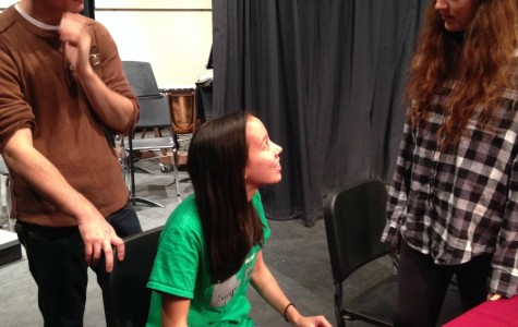 Director Zachary Roberts works with seniors Liesl Jaeger and Jordan Goodson.