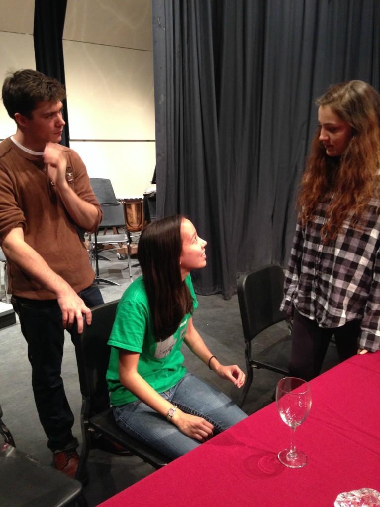 Director Zachary Roberts works with seniors Liesl Jaeger and Jordan Goodson.